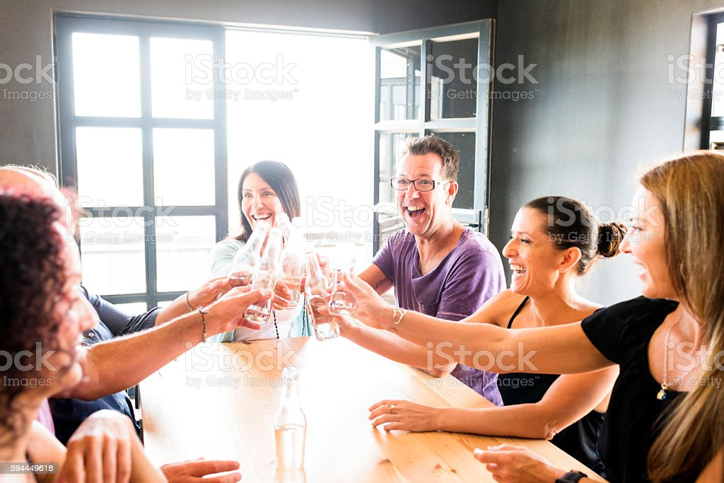Group Of Friends Enjoying Drinks Together At A Brewery stock photo