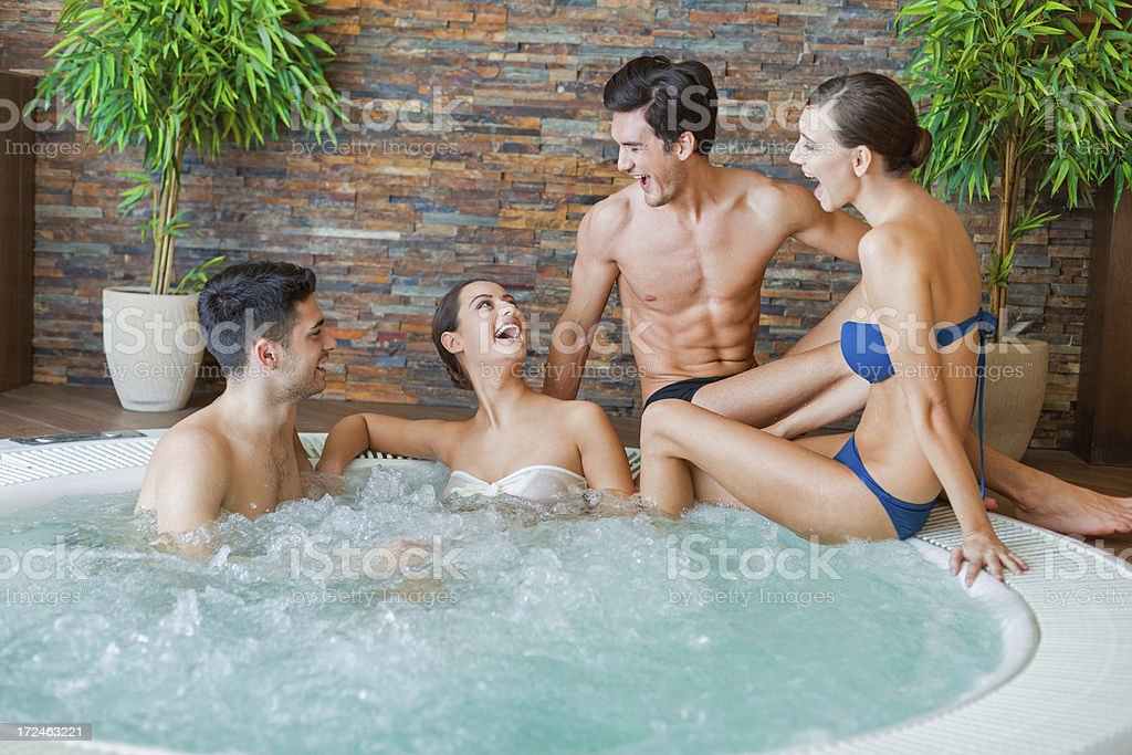 Group of friends enjoying in jacuzzi royalty-free stock photo