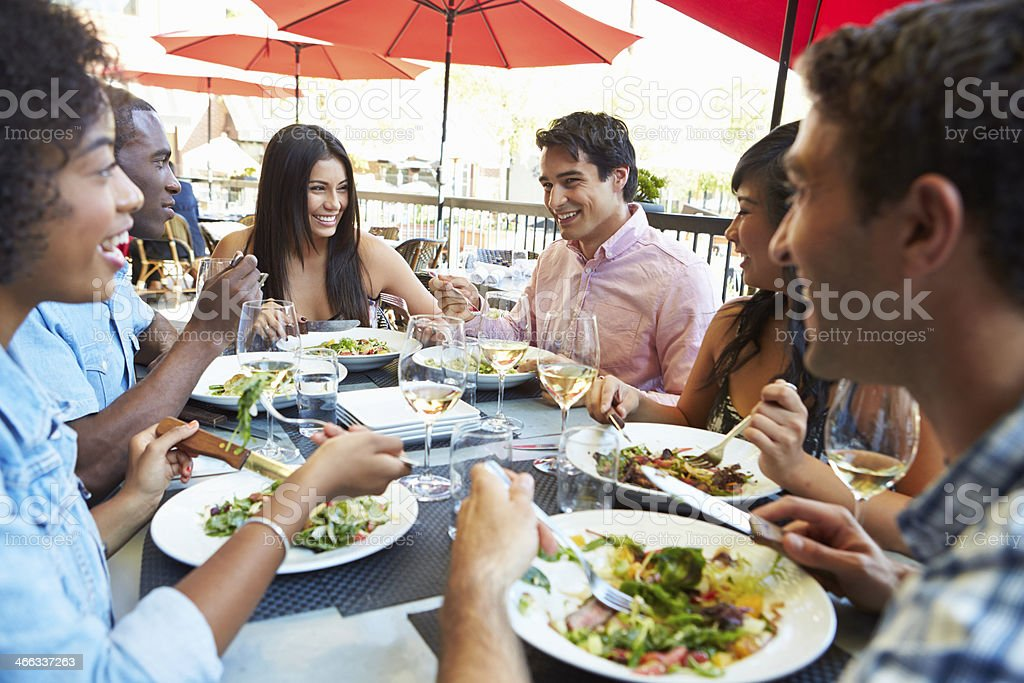 Group Of Friends Enjoying Meal At Outdoor Restaurant royalty-free stock photo