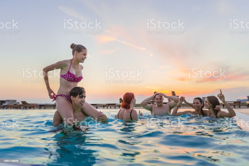 Group of friends enjoying the pool party stock photo
