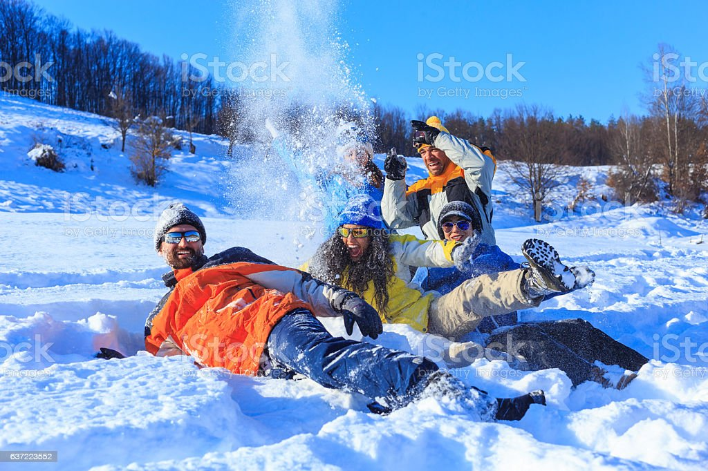 Group of friends enjoying the snow stock photo