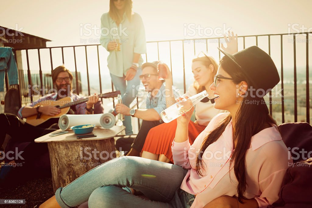 group of friends enjoying their own party stock photo