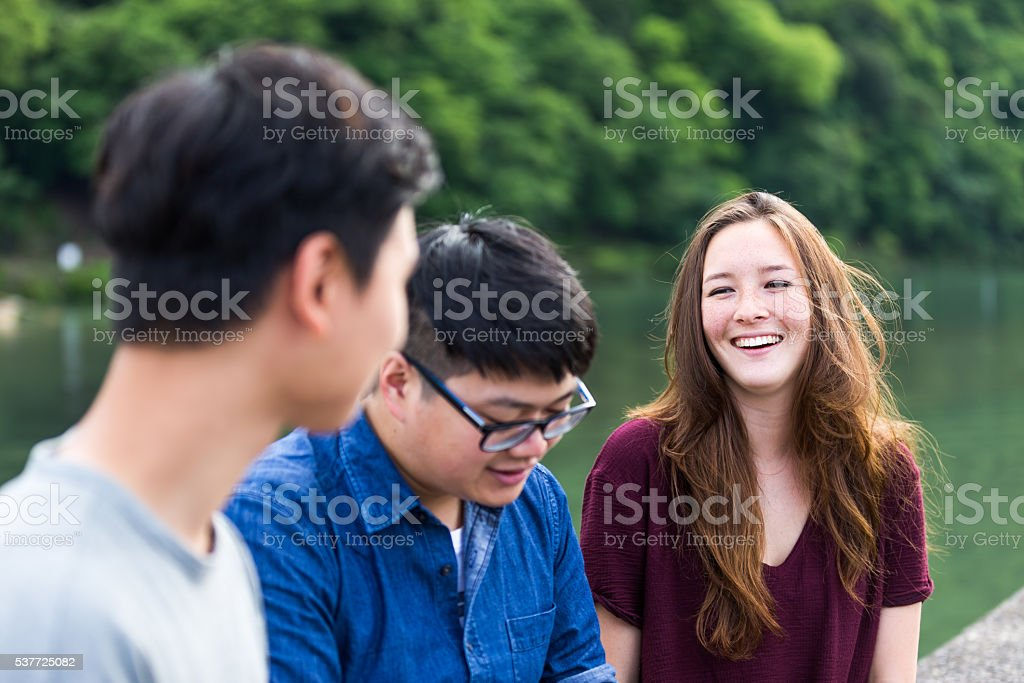 Group of friends enjoying their weekend near a lake stock photo