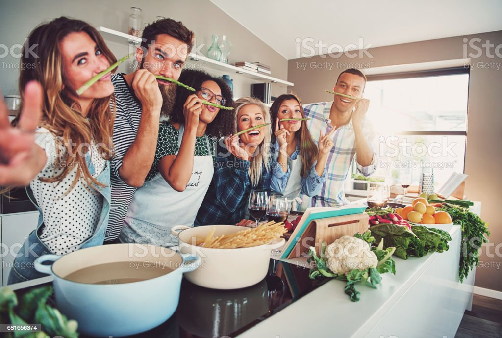 Group of friends fooling with asparagus stock photo