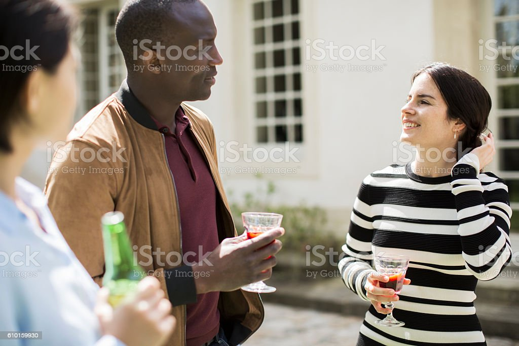 Group of friends gather to celebrate in a luxury garden stock photo
