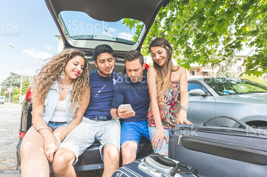 Group of friends getting ready to leave for vacations stock photo