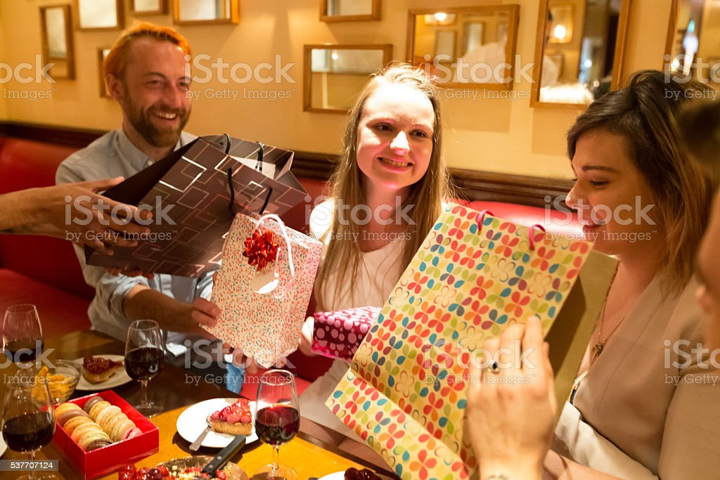 Group of Friends Giving Gifts to the Birthday Girl stock photo