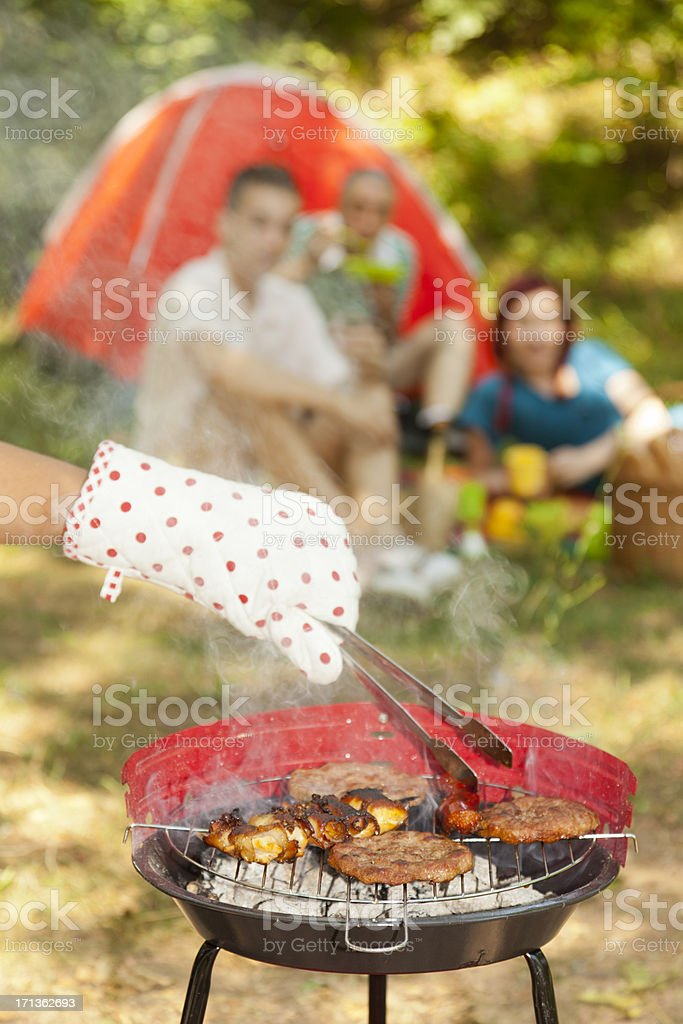 Group of friends grilling royalty-free stock photo