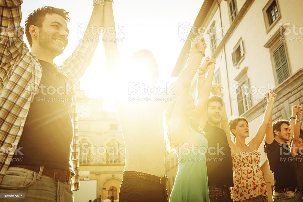 Group of friends hands up together royalty-free stock photo