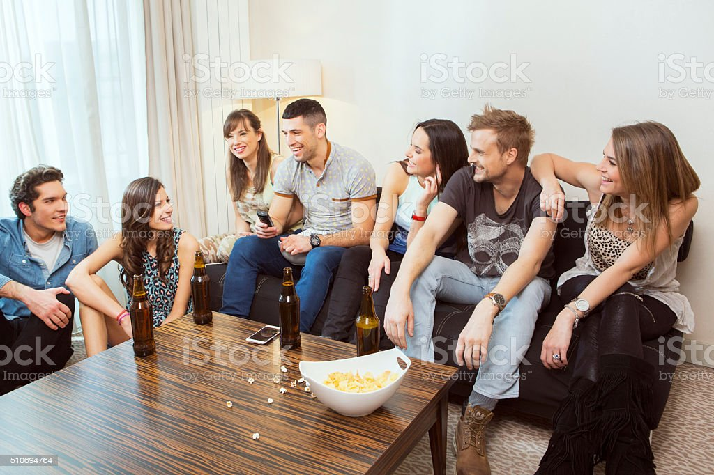 Group of friends hanging out at home stock photo