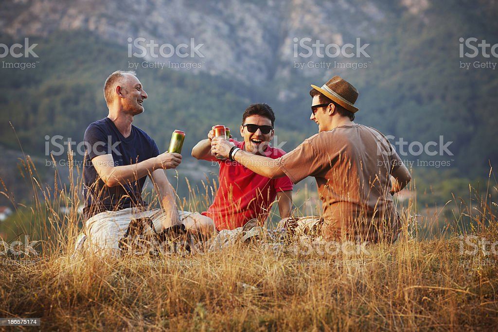 group of friends having a beer stock photo