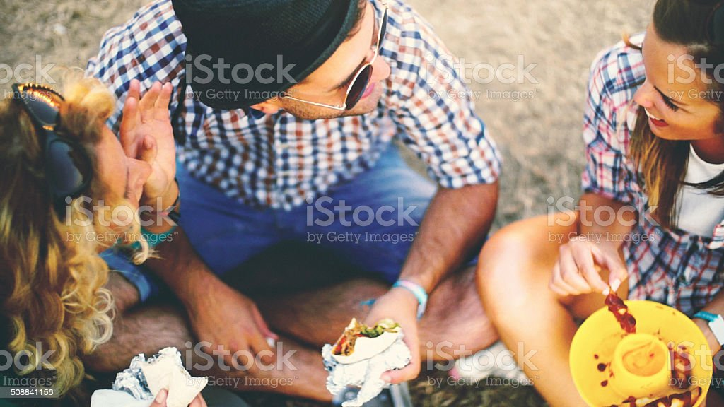 Group of friends having a bite. stock photo