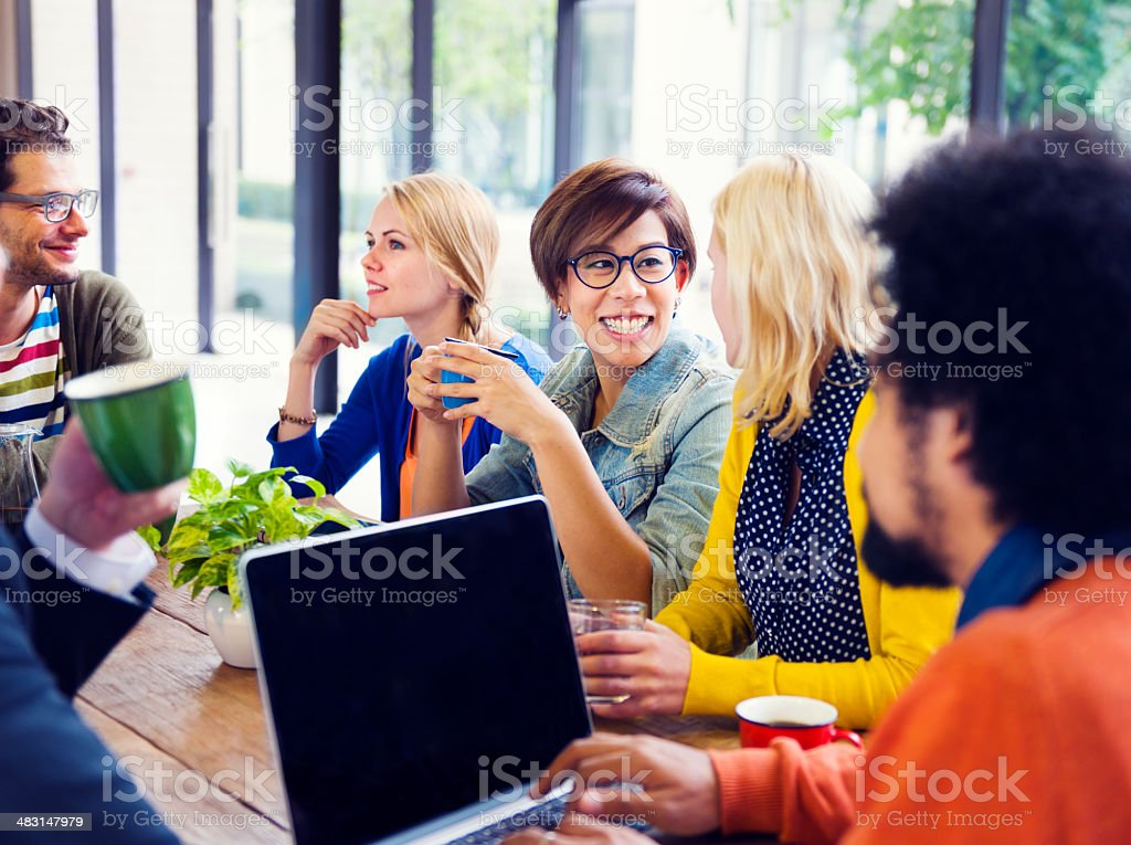 Group of Friends Having a Coffee Break in Cafe stock photo