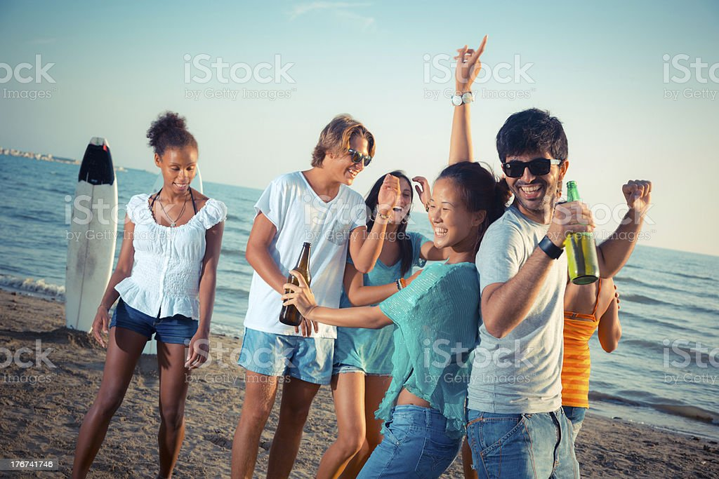 Group of Friends Having a Party at Beach royalty-free stock photo