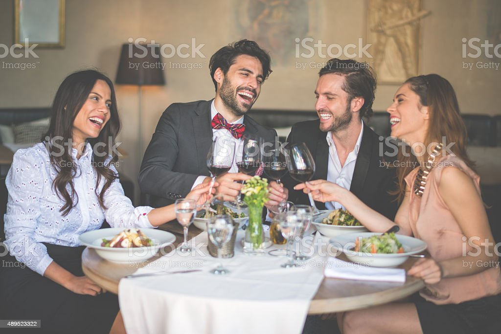 Group of friends having a toast stock photo