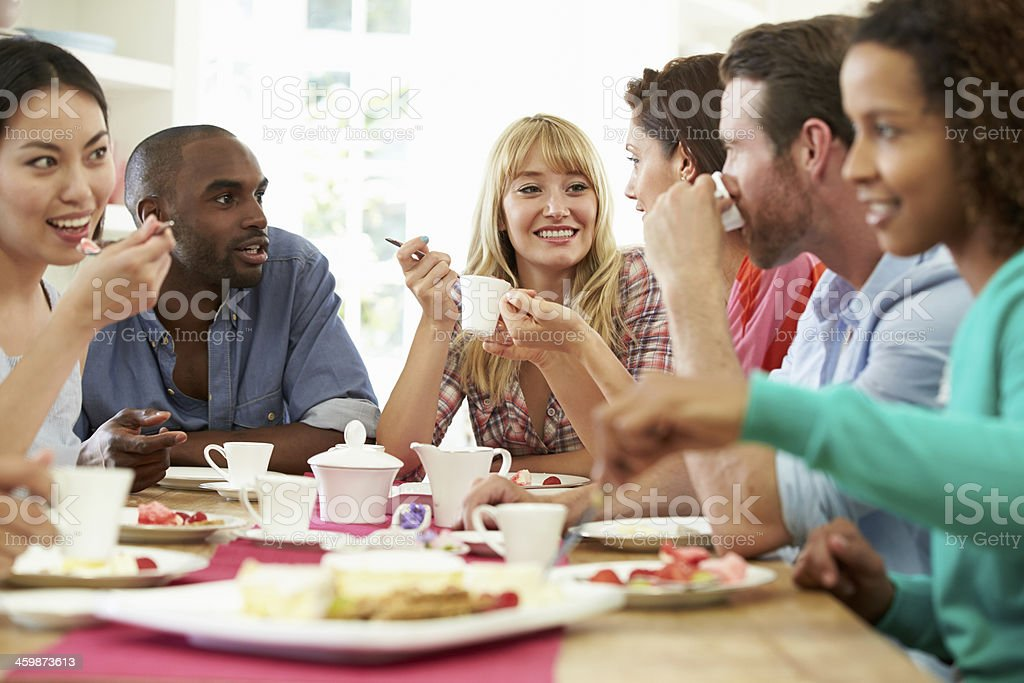 Group Of Friends Having Cheese And Coffee Dinner Party stock photo
