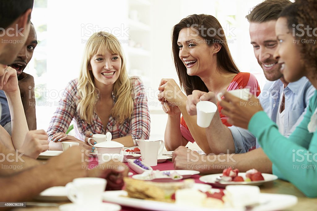Group Of Friends Having Cheese And Coffee Dinner Party royalty-free stock photo