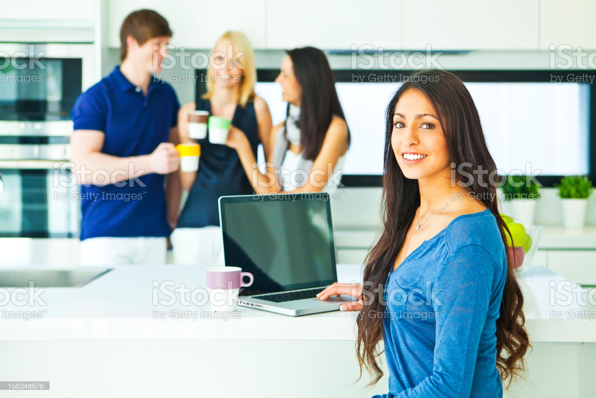 Group of friends having coffee in a modern kitchen royalty-free stock photo