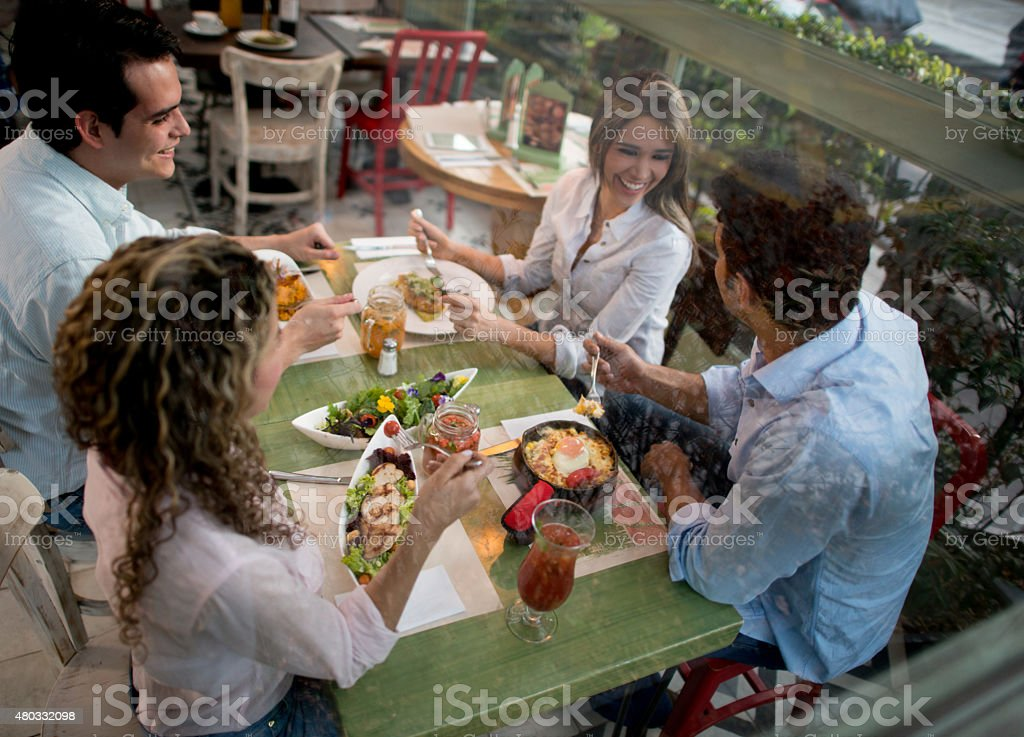 Group of friends having dinner at a restaurant stock photo