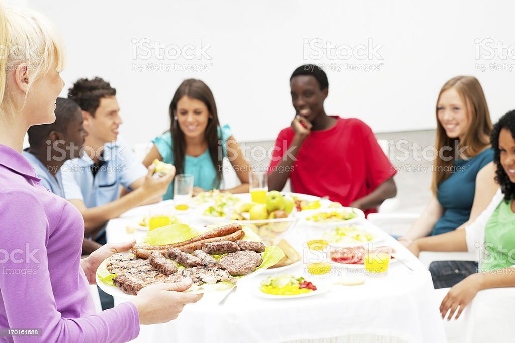 Group of friends having dinner outside. royalty-free stock photo
