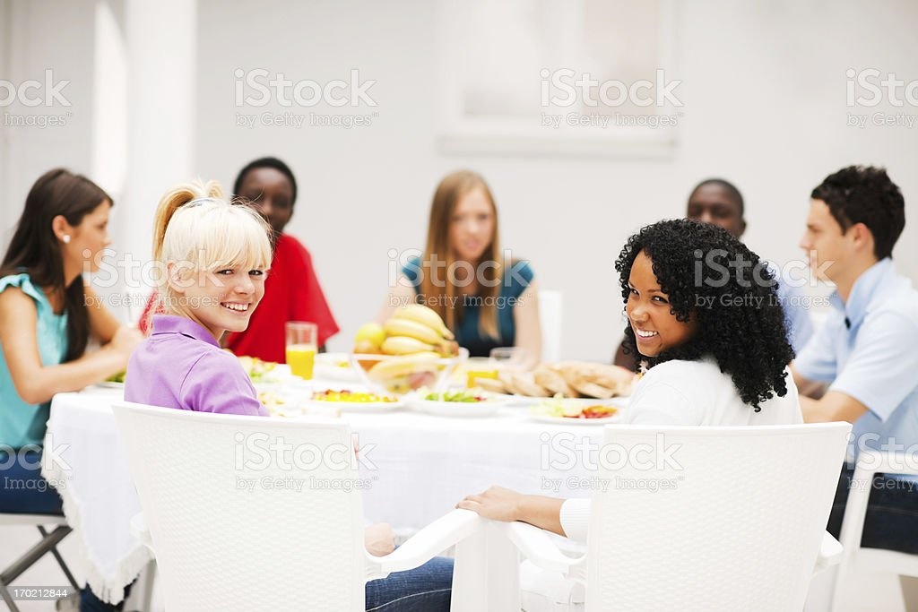 Group of friends having dinner outside royalty-free stock photo