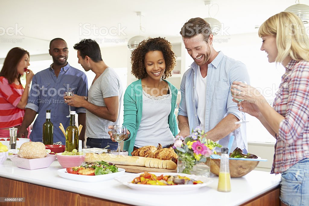 Group Of Friends Having Dinner Party At Home stock photo