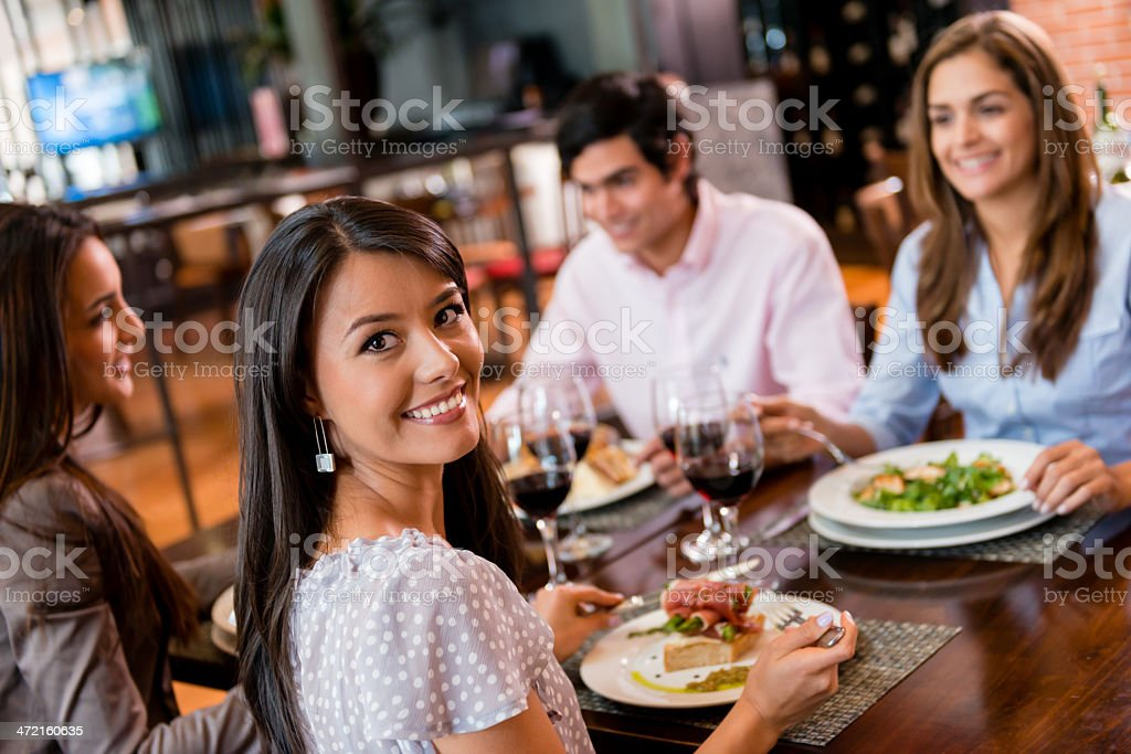 Group of friends having dinner stock photo