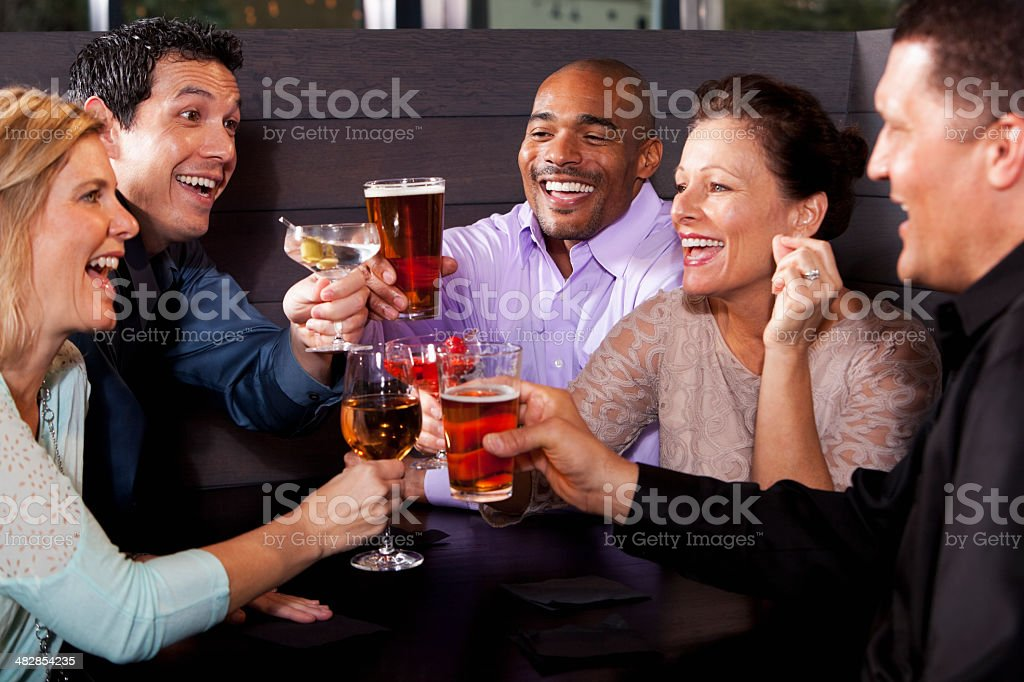 Group of friends having drinks at restaurant stock photo