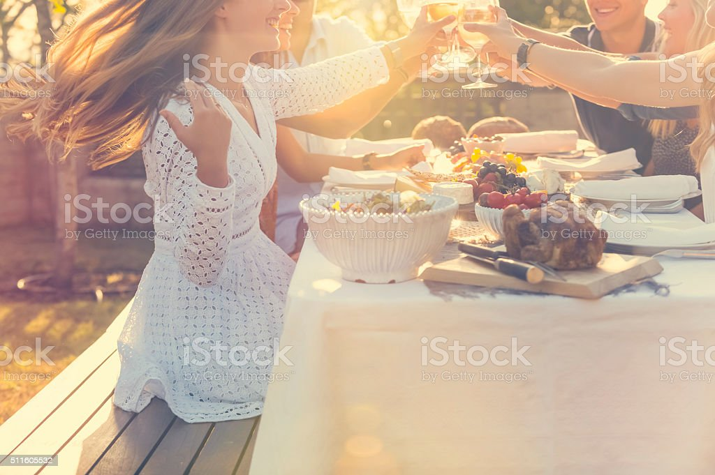 Group of friends having drinks at sunset. stock photo