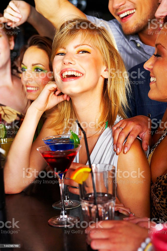 Group of friends having fun at a nightclub stock photo