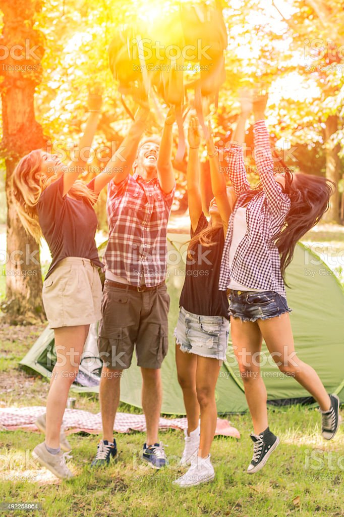 Group of friends having fun at camping stock photo
