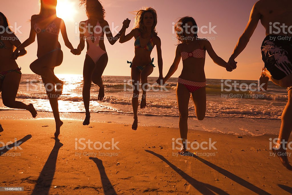 Group of friends having fun at the beach royalty-free stock photo