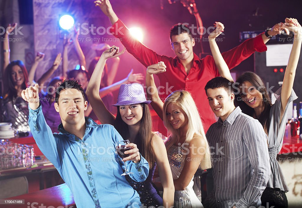 Group of friends having fun at the disco club. royalty-free stock photo