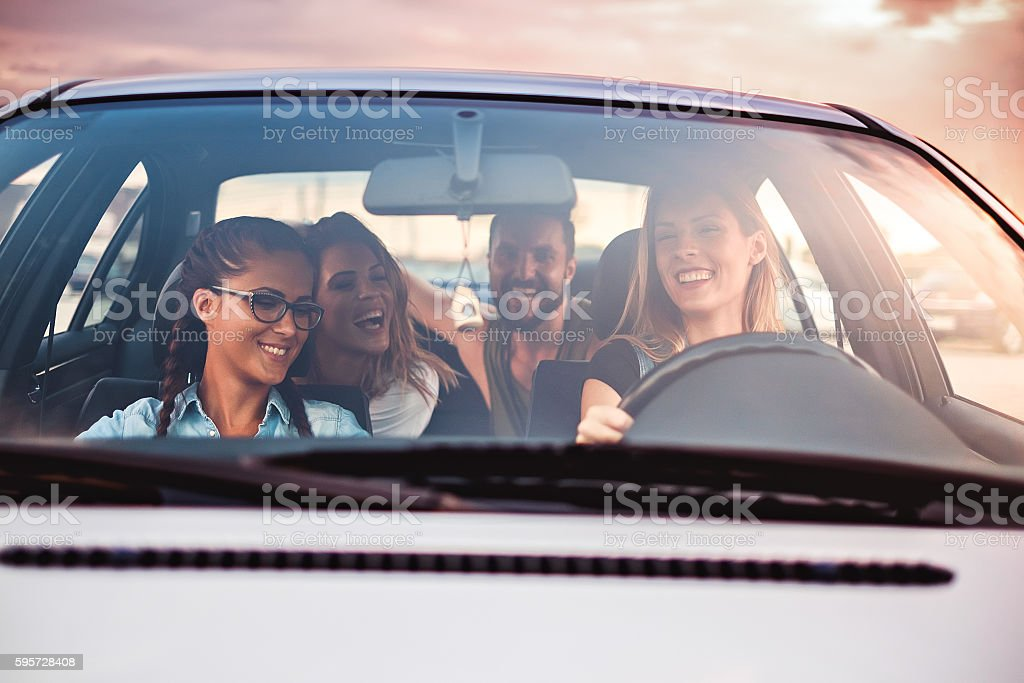 Group of friends having fun in the car stock photo