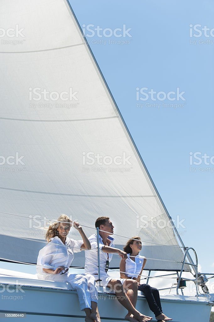 Group of friends having fun on a yacht royalty-free stock photo