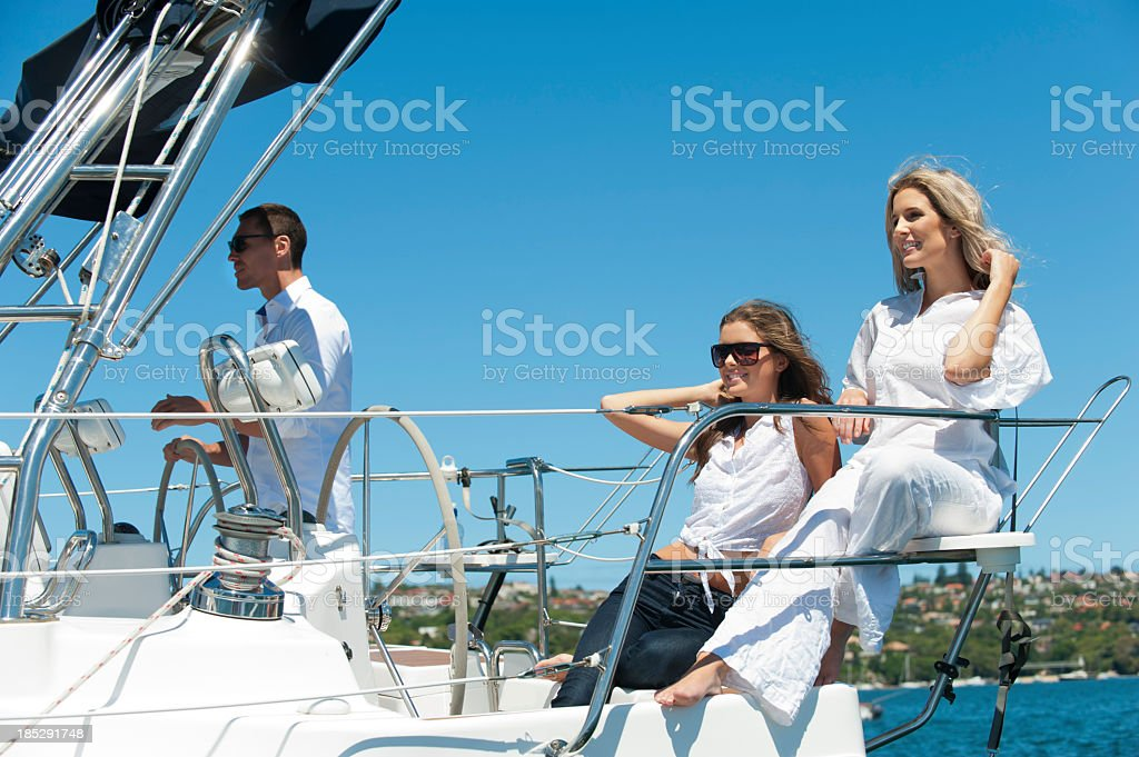 Group of friends having fun on a yacht stock photo
