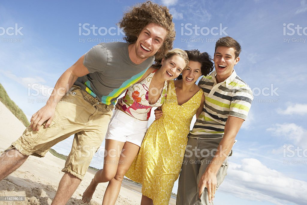 Group Of Friends Having Fun On Summer Beach stock photo