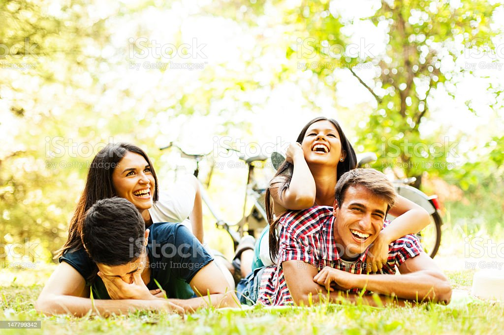 Group of friends having fun outdoors royalty-free stock photo