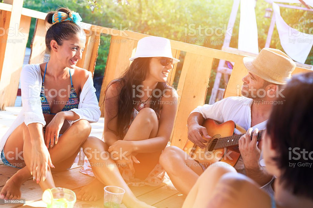 Group of friends having fun together on pavilion stock photo