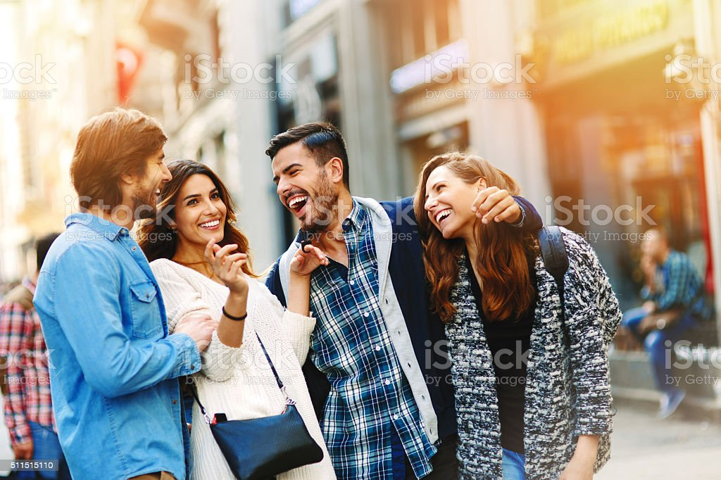 Group of friends having good time in the city stock photo