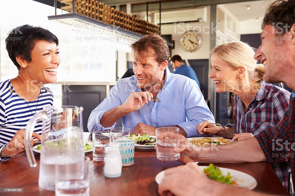 Group of friends having lunch in a restaurant stock photo