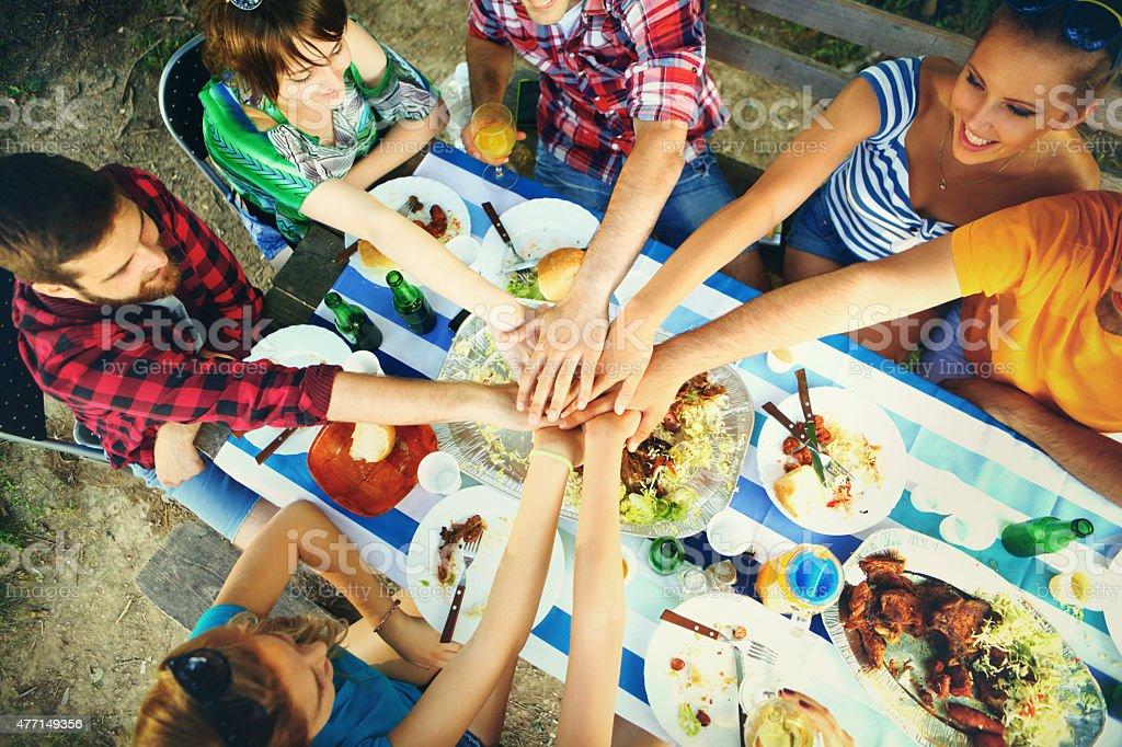Group of friends having lunch outdoors. stock photo