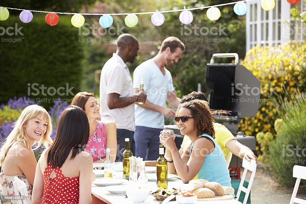 Group Of Friends Having Outdoor Barbeque At Home royalty-free stock photo