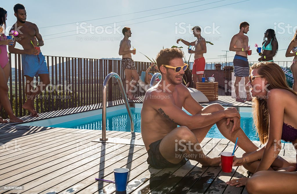 Group Of Friends Having Pool Party stock photo