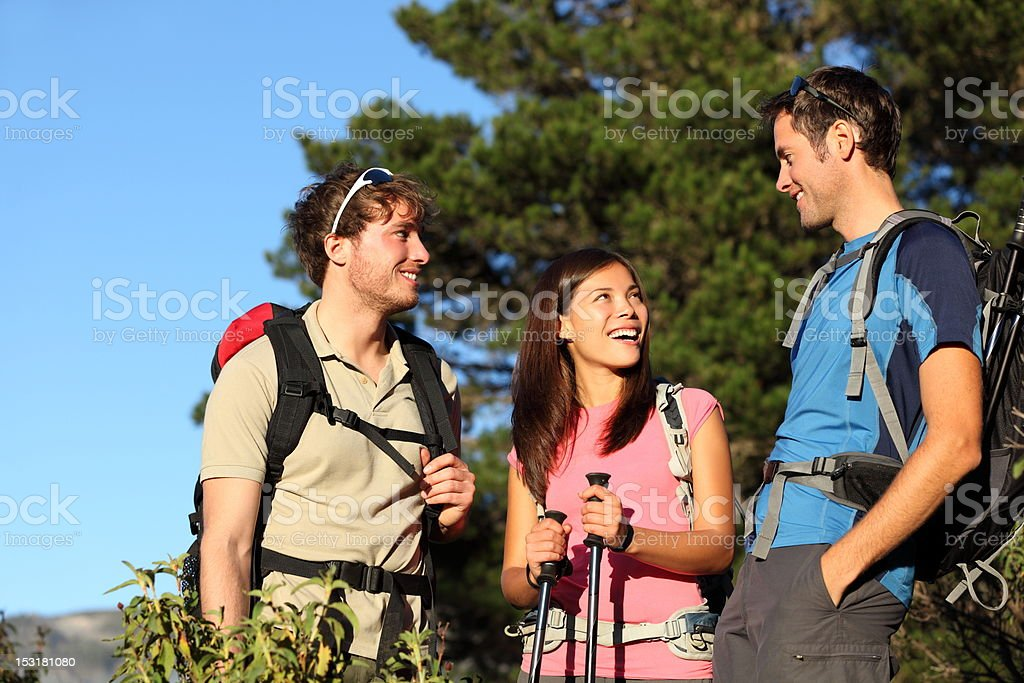 Group of friends hiking royalty-free stock photo