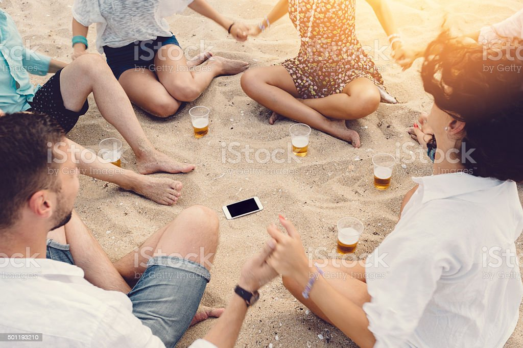 Group of friends holding hands together to show solidarity stock photo