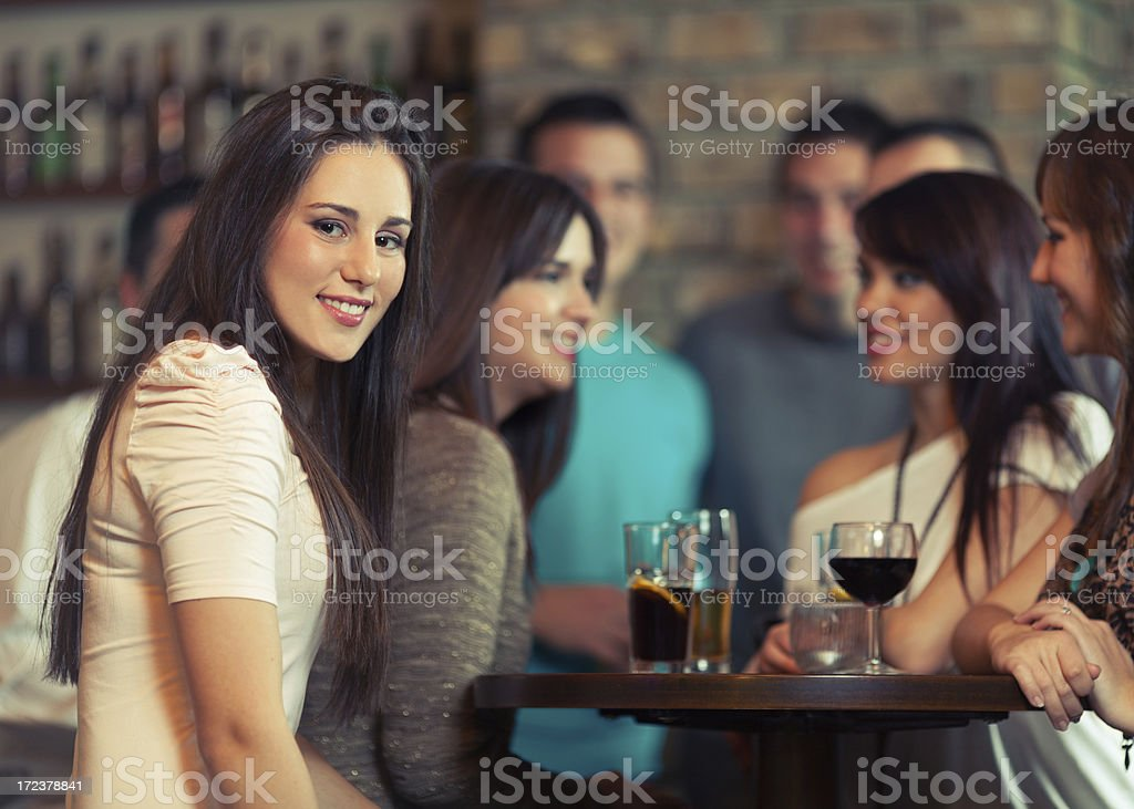 Group of friends in a bar royalty-free stock photo