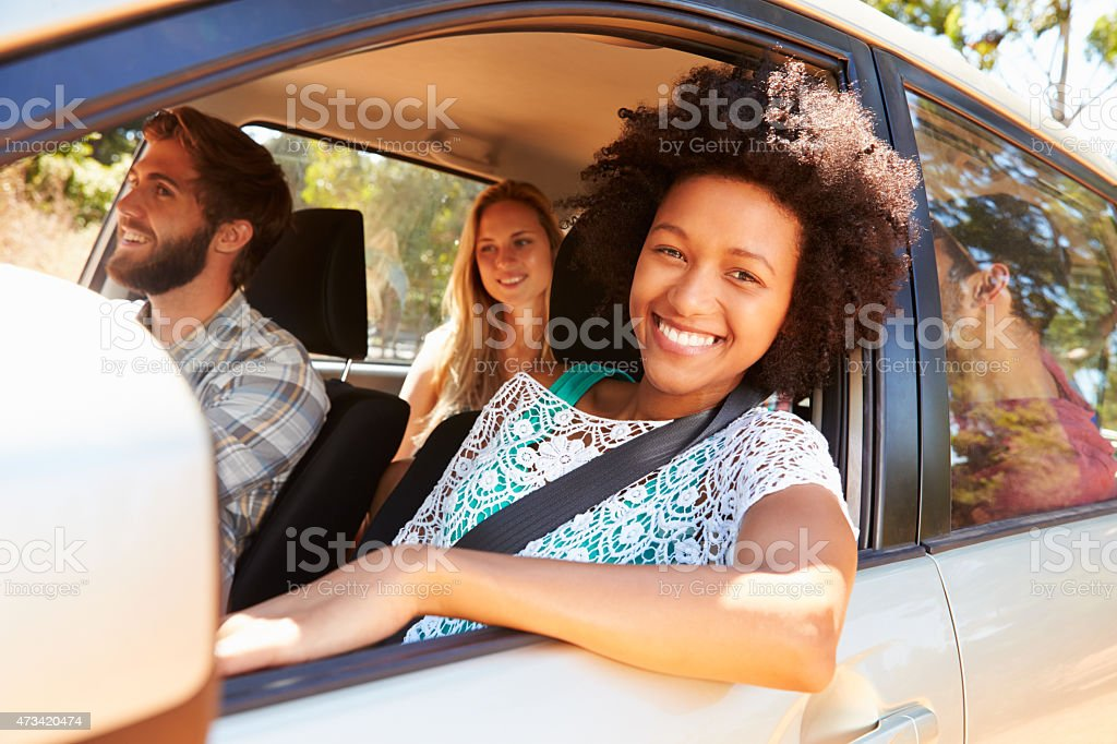 Group of friends in a car going on a trip stock photo