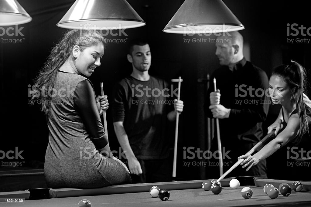 Group of friends in a local pool hall stock photo