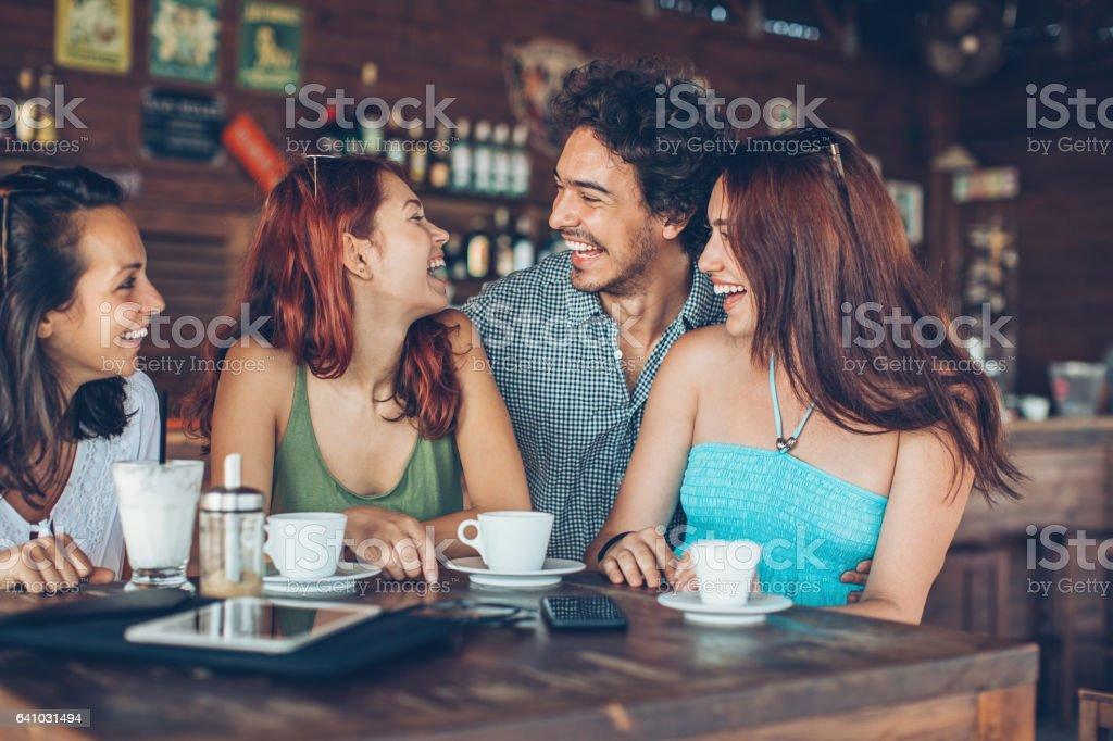 Group of friends in cafe in the summer stock photo